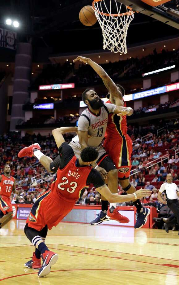 Houston Rockets' James Harden (13) charges into New Orleans Pelicans' Anthony Davis (23) as Alonzo Gee, right, helps defend during the second half of an NBA basketball game Wednesday, March 2, 2016, in Houston. Houston won 100-95. (AP Photo/David J. Phillip) Photo: David J. Phillip, Associated Press / AP