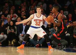 NEW YORK, NY - FEBRUARY 22:  Jimmer Fredette #32 of the New York Knicks in action against the Toronto Raptors during their game at Madison Square Garden on February 22, 2016 in New York City.  NOTE TO USER: User expressly acknowledges and agrees that, by downloading and/or using this Photograph, user is consenting to the terms and conditions of the Getty Images License Agreement.  (Photo by Al Bello/Getty Images) ORG XMIT: 575731177