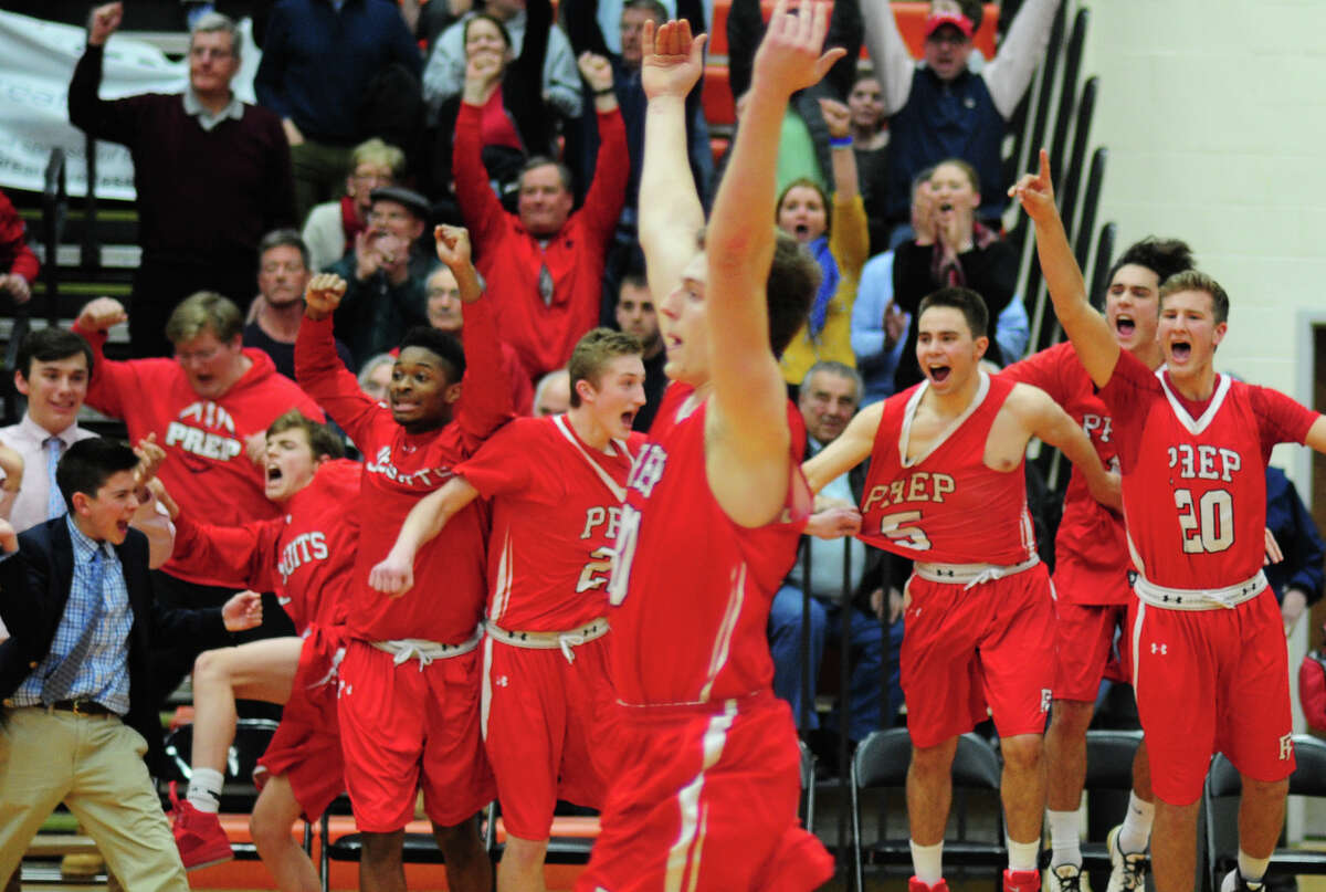Fairfield Prep celebrates its win over Hillhouse in SCC Boys' Basketball Championship action in Shelton, Conn., on Wedesday Mar. 2, 2016.