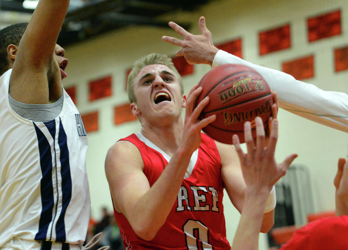 Fairfield Prep's Rich Kelly goes between two Hillhouse defenders to the basket during SCC Boys' Basketball Championship action in Shelton, Conn., on Wedesday Mar. 2, 2016.
