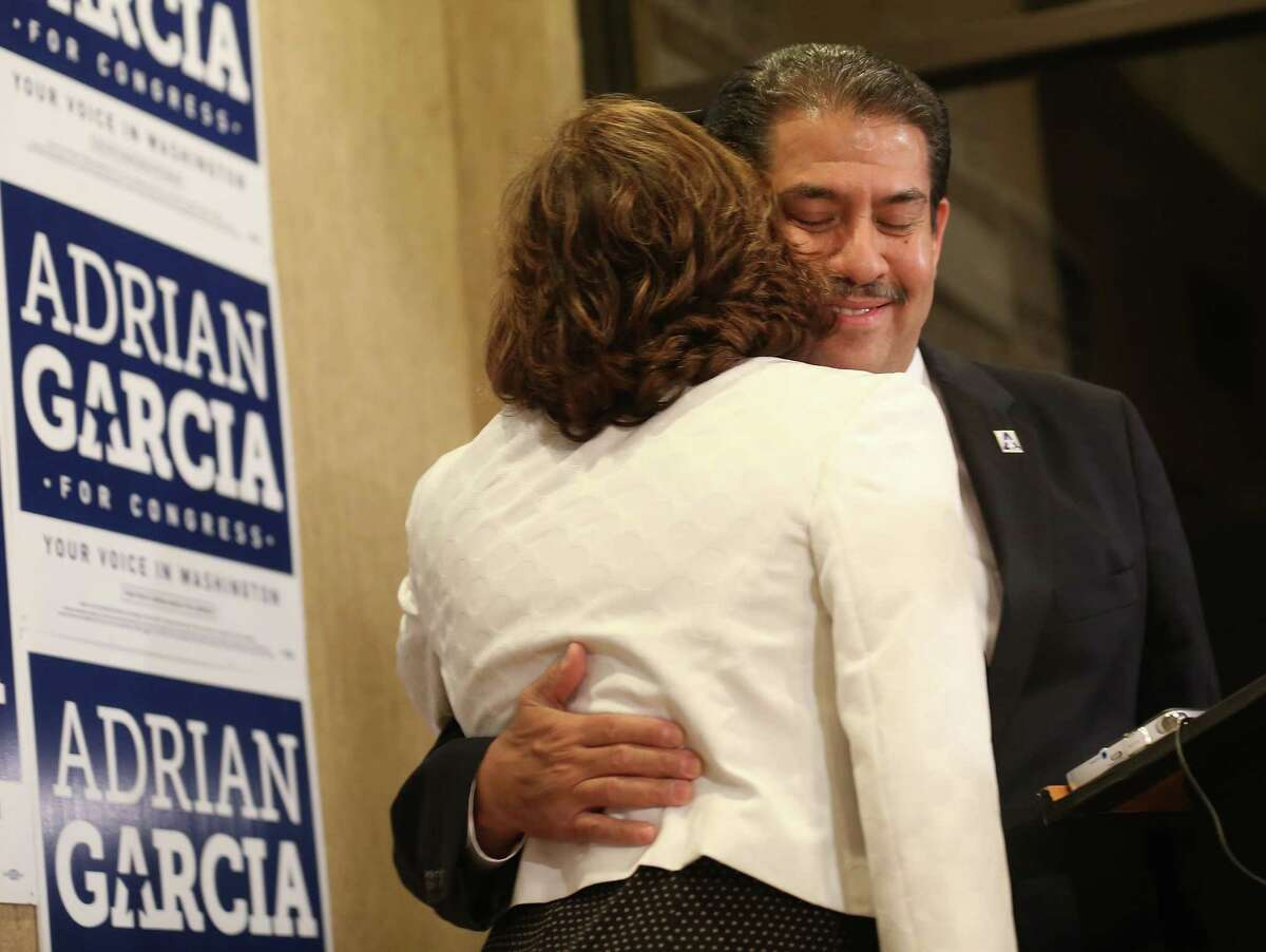 Primary congressmen candidate Adrian Garcia hugs his wife, Monica, before talking to his supporters at his headquarters after losing the democratic congressional primary on Tuesday, March 1, 2016, in Houston.