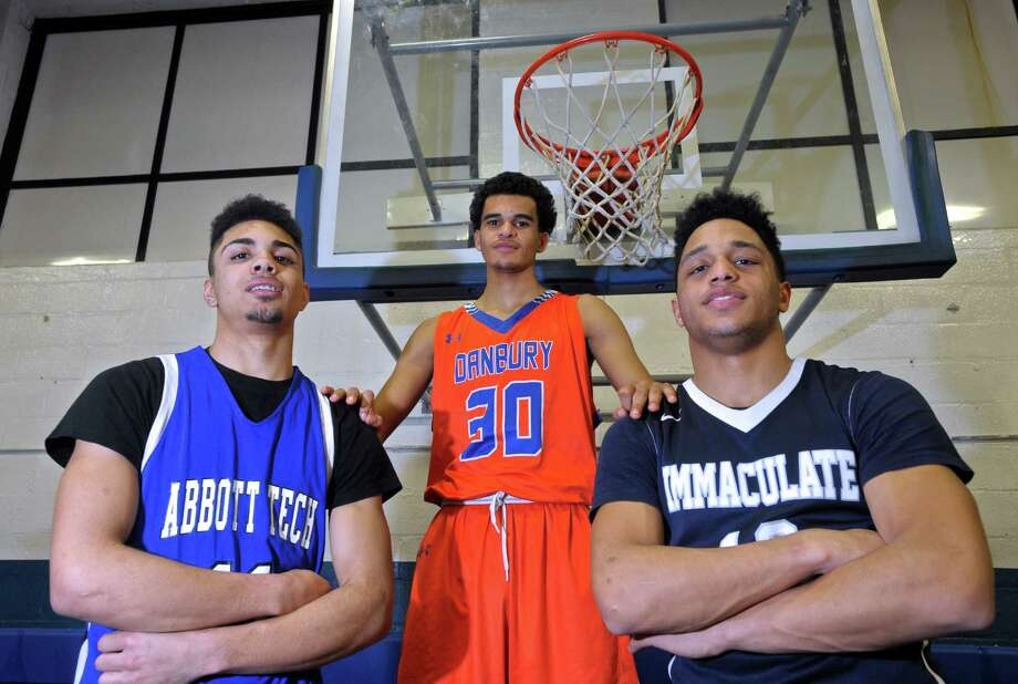 Three Danbury high schools, Abbott Tech, Danbury and Immaculate, are playing for their league's boys basketball championship on Thursday. Representing their schools are, from left, Nick Placella from Abbott Tech, Scott Nesbitt from Danbury High School and Darius Smith from Immaculate High School. Photo: H John Voorhees III / Hearst Connecticut Media / The News-Times