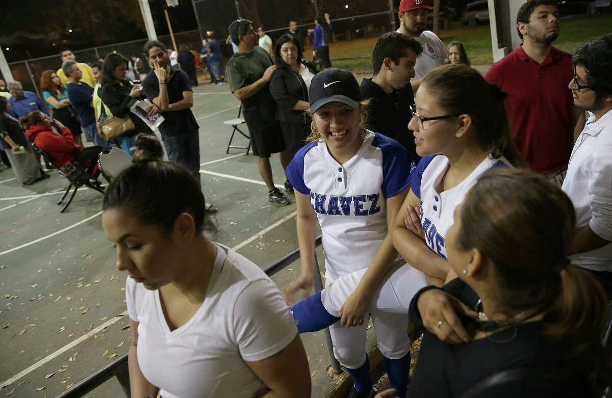Jasmine Ward, 18, left, and Stephanie Martinez, 19, seniors at Chavez High School wait in line to vote at DeZavala Park Community Center on Tuesday, March 1, 2016, in Houston. The two came to vote right after their softball game and had been waiting for over an hour to get into the polling station.
