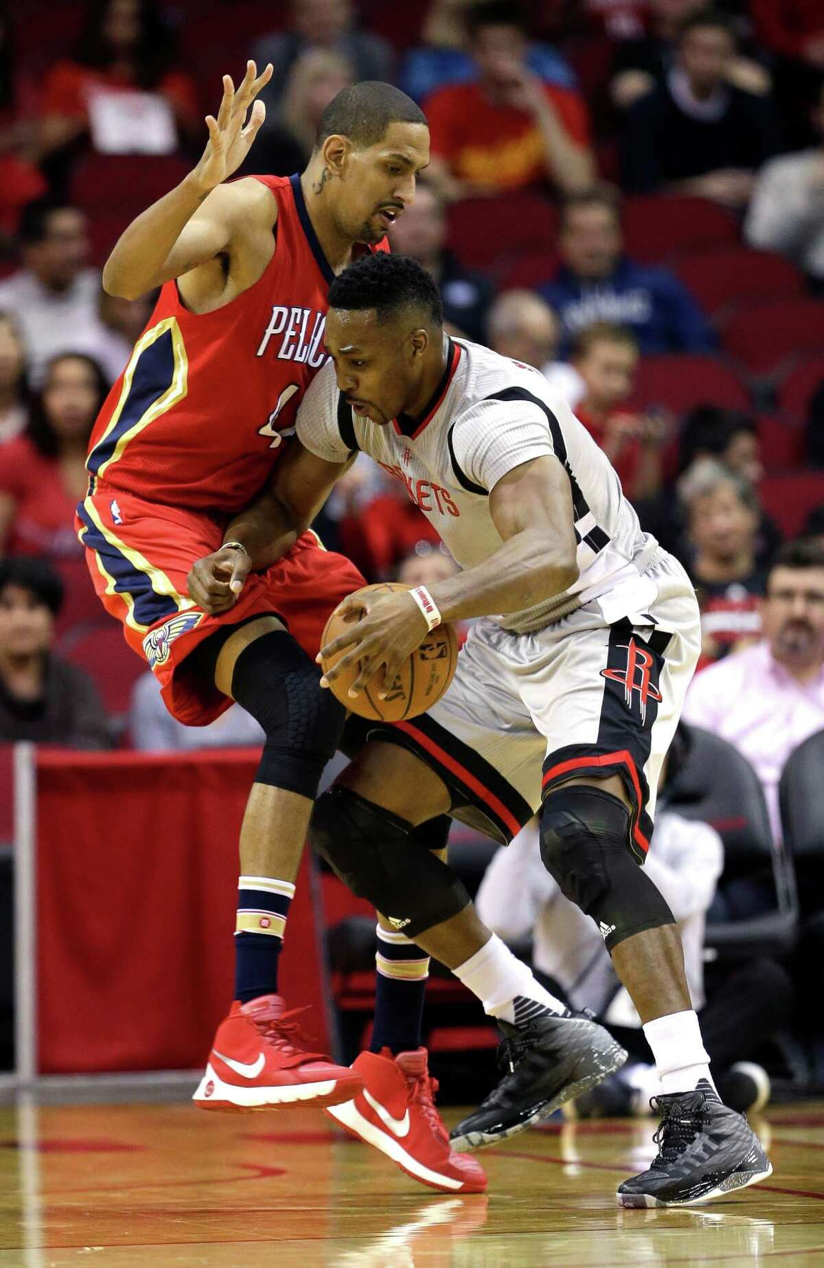 Rockets center Dwight Howard, right, gets leverage as the Pelicans' Alexis Ajinca tries to stand his ground. Howard muscled up inside to score 16 points on 5-of-6 shooting. He was 6-for-10 from the free-throw line.
