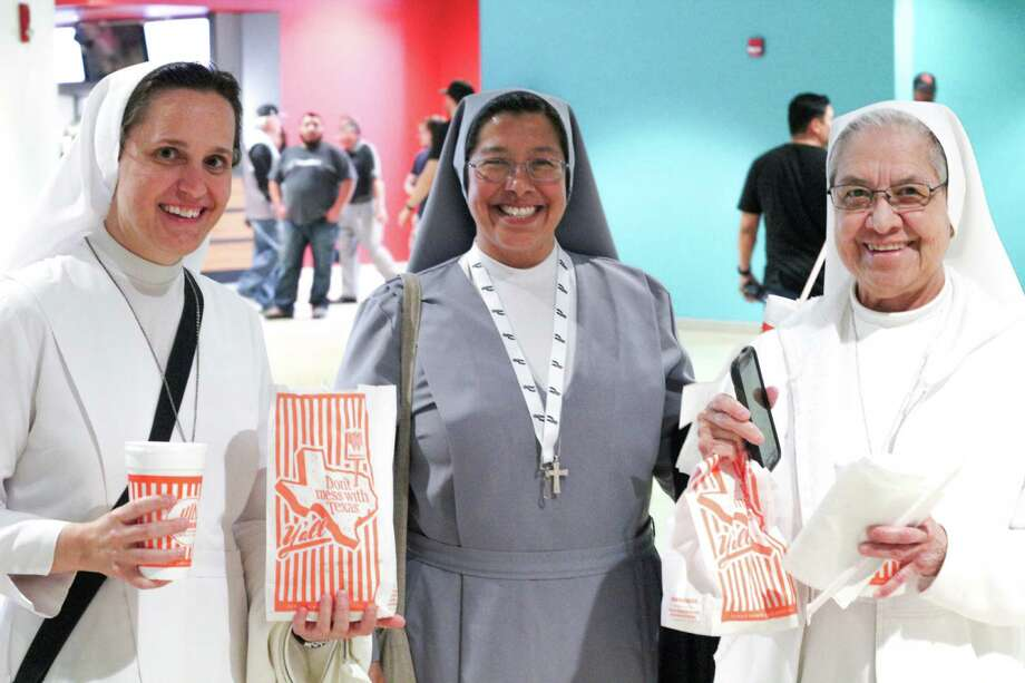 Left to right: Salesian Sisters Jeanette Palasota, Margaret Natal and Lourdes Trevino of St. John Bosco enjoy the Spurs and Whataburger snacks at a March 2 game against the Detroit Pistons. Photo: By Jason Gaines / For MySA.com