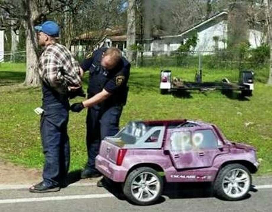 A 26-year-old East Texas man couldn't put up much of a chase, even if he wanted to, when he was pulled over for alleged credit card theft in his pink Power Wheel Cadillac Escalade, which tops out at about 5 mph. Photo: Provided By The Cleveland Advocate