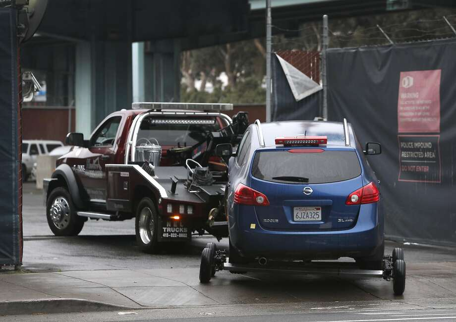 A tow truck pulls a car into the authorized vehicle impound lot in San Francisco, Calif. on Thursday, March 3, 2016. San Francisco has among the highest towing fees in the nation, typically running around $500 not including the cost of the parking violation. Photo: Paul Chinn, The Chronicle