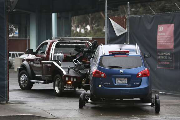 A tow truck pulls a car into the authorized vehicle impound lot in San Francisco, Calif. on Thursday, March 3, 2016. San Francisco has among the highest towing fees in the nation, typically running around $500 not including the cost of the parking violation.