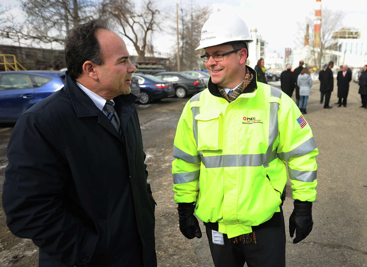 Bridgeport Mayor Joe Ganim, left, talks with Plant Manager Mike Stagliola before the announcement of a new PSEG natural gas buring power plant on the company's property at the mouth of Bridgeport Harbor in Bridgeport, Conn. on Thursday, February 11, 2016.