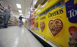 This June 16, 2011 file photo shows boxes of Cheerios in a store in Akron, N.Y. Large food companies are trying to head off state-by-state efforts to enact mandatory labeling of genetically modified ingredients by proposing new voluntary labels nationwide. The food industry and farm groups are pushing Congress to pass legislation that would require the Food and Drug Administration to create guidelines for the new labels, which food manufacturers could use. (AP Photo/David Duprey, File)