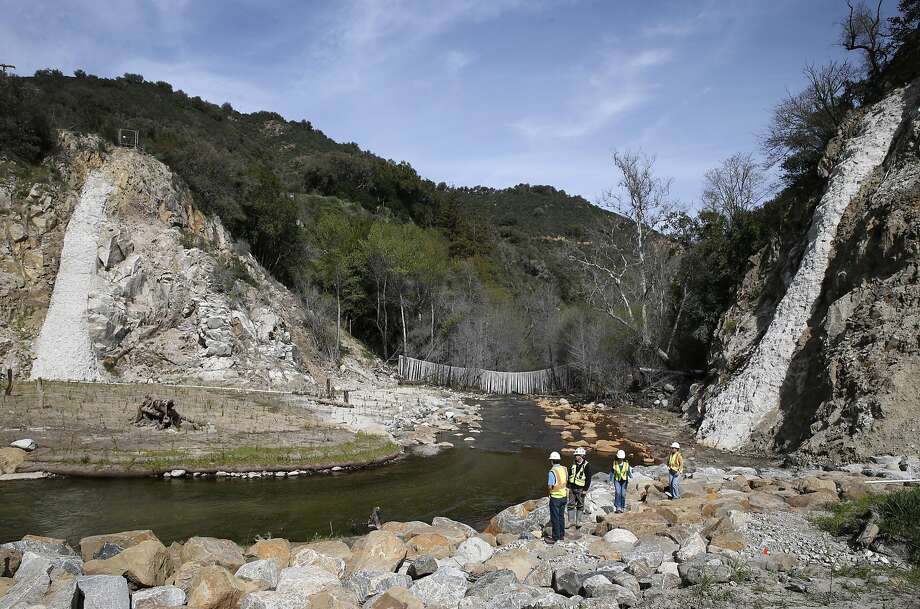 Remnants of the old San Clemente Dam remain on either side of the Carmel River, which flows again in Carmel Valley, Calif. on Wednesday, March 2, 2016 after the removal of the dam last year. Native vegetation is being replanted and to restore the natural habitat along the banks of the Carmel River and salmon is returning to spawn now that the 106-foot concrete dam has been removed. Photo: Paul Chinn, The Chronicle