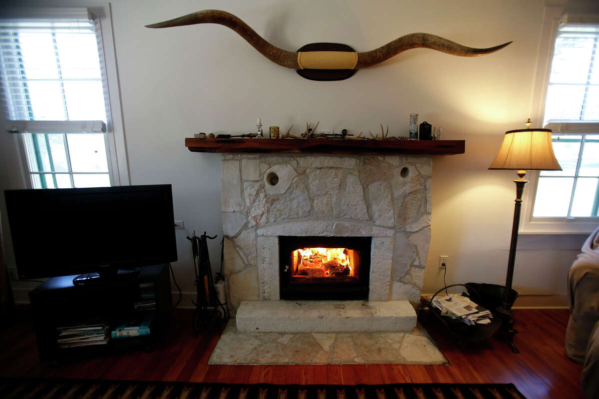 A seven-foot longhorn spread, from the last feral longhorn on the Dobie Paisano Ranch west of Austin, adorns the wall over the fireplace in the ranch house living room.