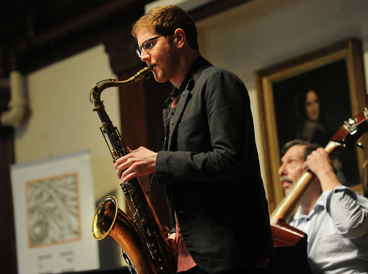 Chris Stelluti on saxophone and Rick Petrone on bass make up half of the WPKN Jazz All-Stars as they perform at the Pequot Library in the Southport section of Fairfield, Conn. on Sunday, February 28, 2016. The concert was a benefit with proceed split between the library and the radio station. The other members of the band are David Childs on piano and Joe Corsella on drums. For fans and collectors of vinyl, WPKN is also hosting Music Mash '16, a record fair on Saturday, March 5 at Read's Artspace at 1042 Broad Street in Bridgeport. Video can be viewed here http://bit.ly/1OUN7Ns
