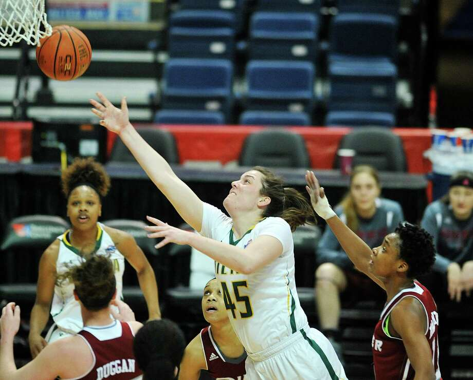 Meghan Donohue of Siena puts up a shot over Rider players during their MAAC Tournament game on Thursday, March 3, 2016, in Albany, N.Y.  (Paul Buckowski / Times Union) Photo: PAUL BUCKOWSKI / 10035654A