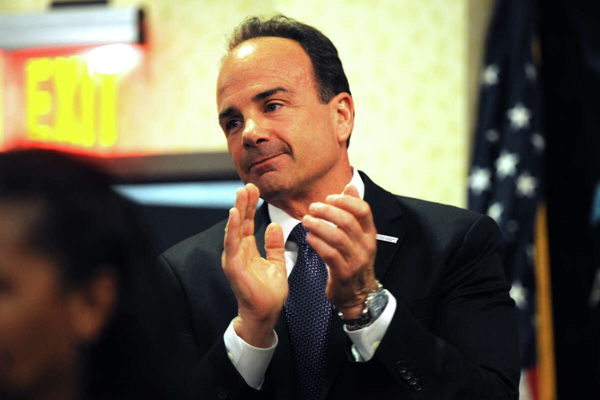 Bridgeport Mayor Joe Ganim takes time out of his speech to share applause with the audience as he addresses the Bridgeport Regional Business Council, in Bridgeport, Conn. March 3, 2016.