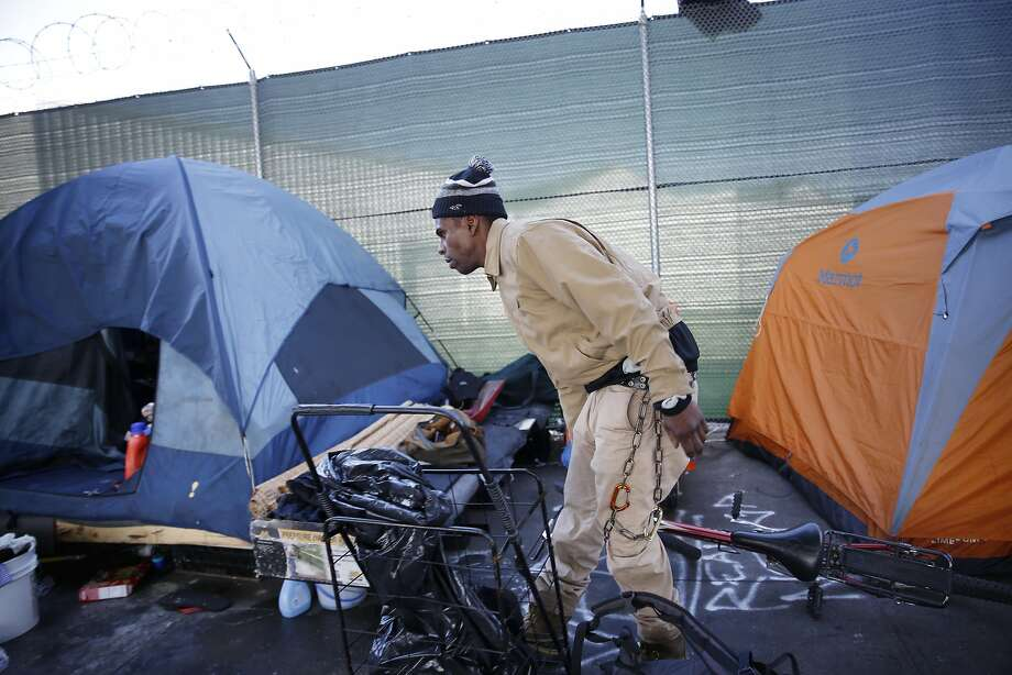 Ashante Jones, homeless resident, lays his bicycle down on the ground outside his tent on 13th Street on Tuesday, Feb. 23, 2016 in San Francisco, California. Photo: Lea Suzuki, The Chronicle