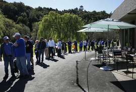 People wait outside to enter the East Bay Regional Park District Board of Directors meeting at the Redwood Canyon Golf Course March 1, 2016 in Castro Valley, Calif. The board was considering whether or not to close Chabot Gun Club, the gun range in Chabot Regional Park due to concerns about lead and noise issues.