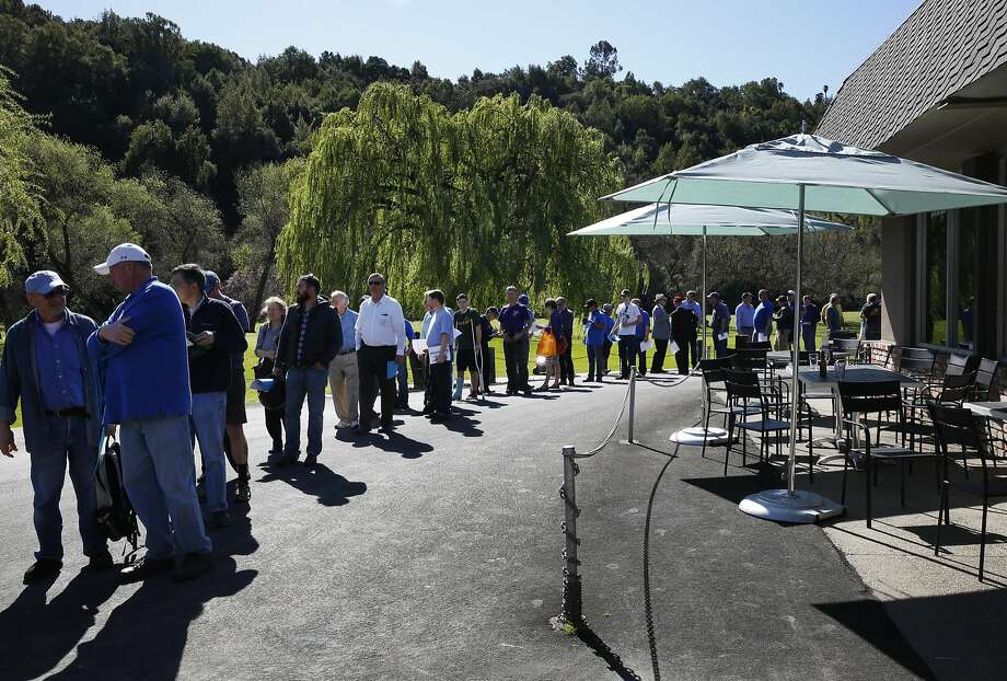 Citizens line up Tuesday to enter the East Bay Regional Park District's Board of Directors meeting in Castro Valley on the Chabot Gun Club. The board voted unanimously to close the gun range for good. Photo: Leah Millis, The Chronicle