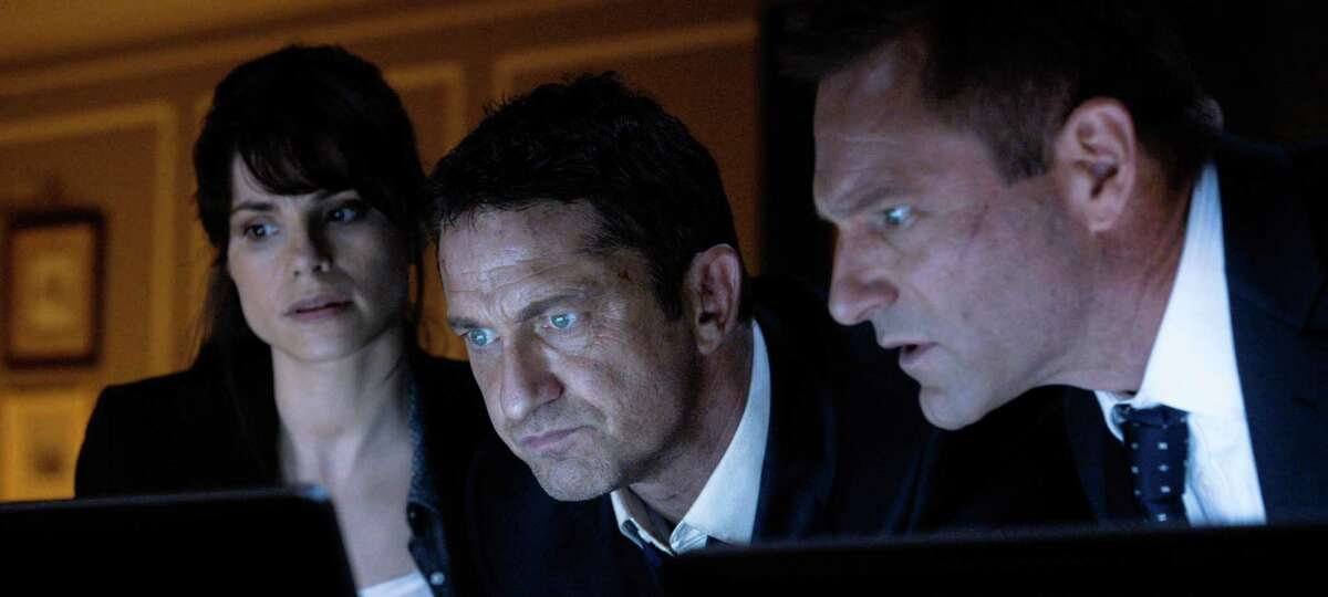 """This image released by Focus Features shows, from left, Charlotte Riley, Gerard Butler and Aaron Eckhart appear in a scene from Grammercy Pictures', """"London Has Fallen."""" (Grammercy Pictures/Focus Features via AP)"""