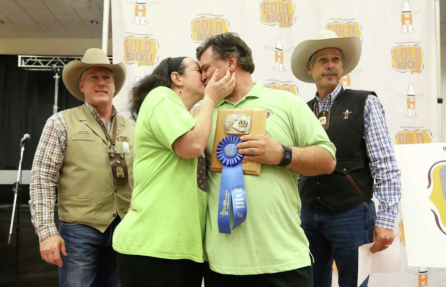 Custom Confections Kimberly and Tony Revis celebrate after winning 3 Gold Buckle Awards at the rodeo on Thursday. Photo: Steve Gonzales / © 2016 Houston Chronicle
