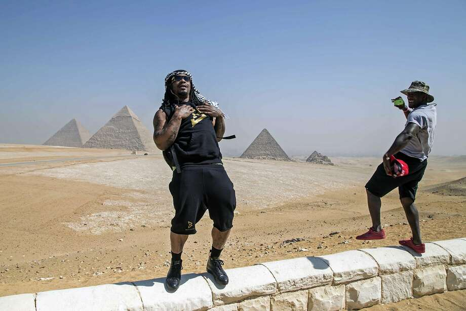 Former running backs Marshawn Lynch and Alvin Bowen visit the Pyramids of Giza in Egypt. They are on a visit with American Football Without Barriers, a non-profit organization. Photo: Roger Anis, AP