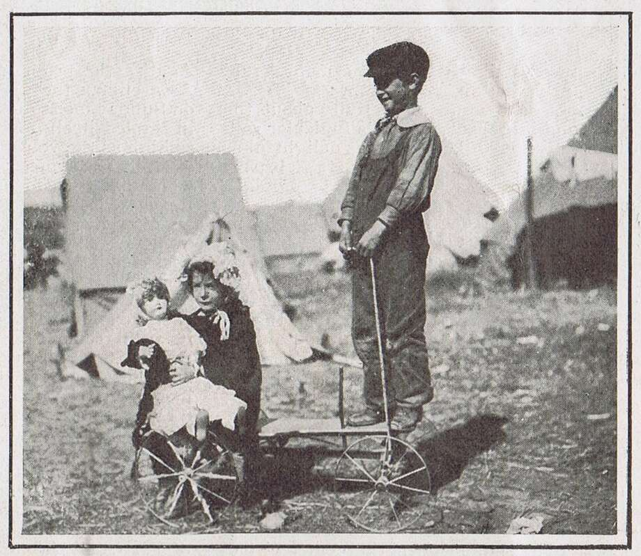 Refugee children, with some of the saved items, camped out in a park after the 1906 San Francisco earthquake and fire.  Colliers Magazine, from the collection of Bob Bragman Photo: Bob Bragman