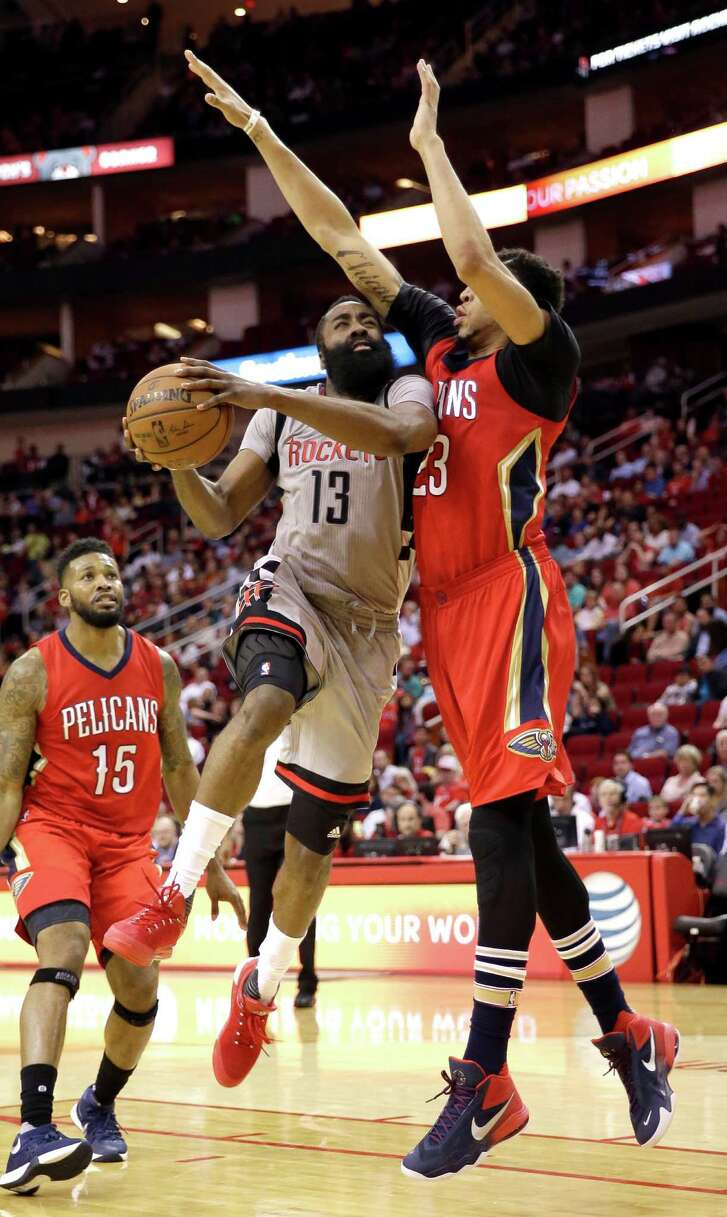 Houston Rockets' James Harden (13) goes up for a shot as New Orleans Pelicans' Anthony Davis (23) defends during the second half of an NBA basketball game Wednesday, March 2, 2016, in Houston. Houston won 100-95.