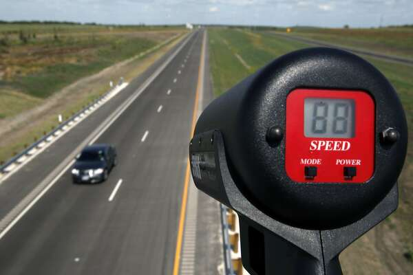 A car is unofficially clocked going 88 mph Wednesday afternoon Oct. 24, 2012 on the southern extension of Texas 130 from Seguin to Austin on the toll road's opening day. The road has the highest speed limit--85 mph--of any road in the country. An Express-News staffer held the radar gun to clock the unofficial speed of the passing vehicles. (AP Photo/San Antonio Express-News, William Luther)