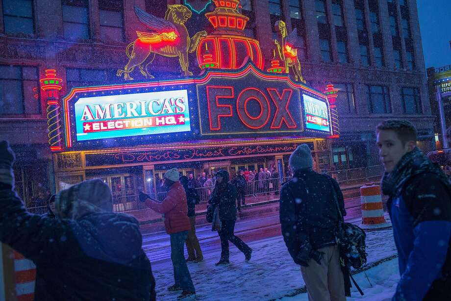 People begin arriving at the Fox Theatre in Detroit to watch the four Republican presidential candidates left standing debate. Photo: Scott Olson, Getty Images