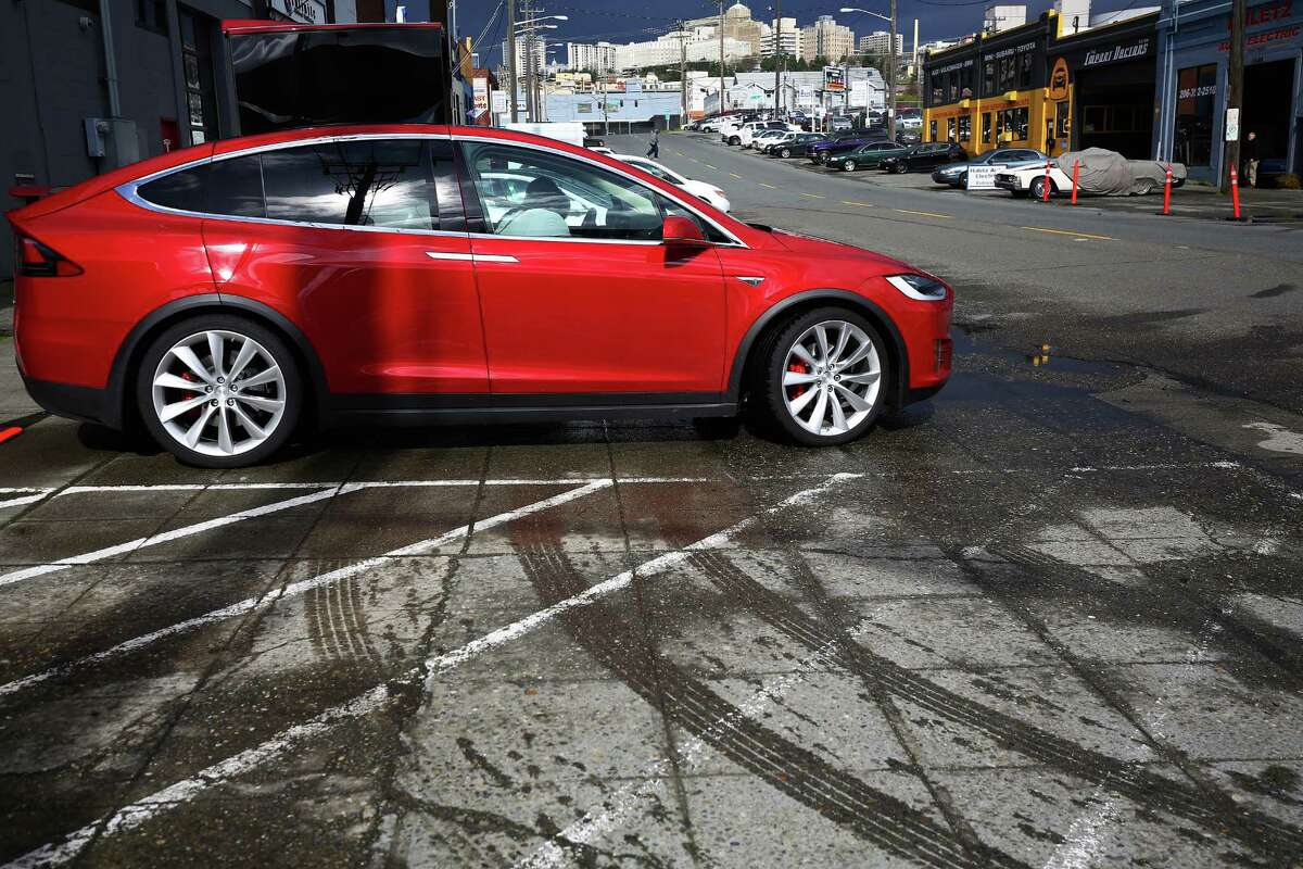Tesla showed off its new Model X to customers at a private event at its Sodo service center, giving them the chance to get up close and personal with the car, Thursday, March 3, 2016.
