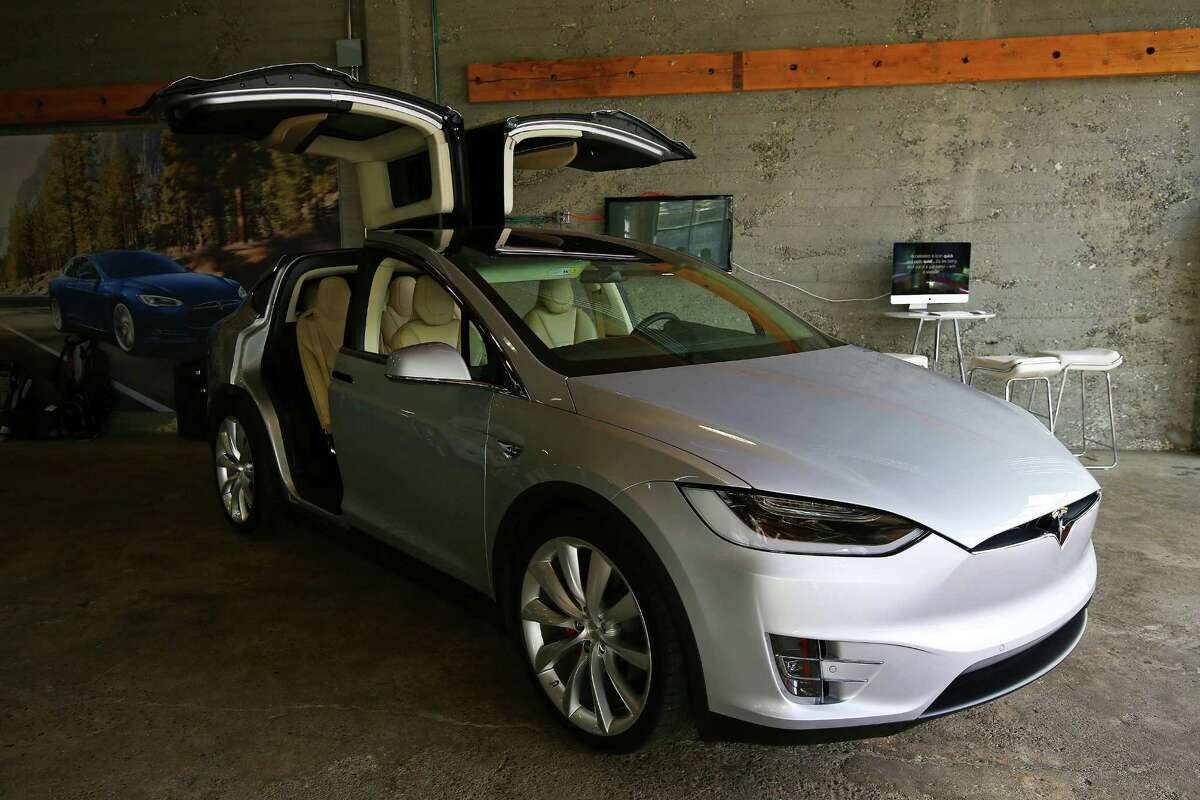 Tesla showed off its new Model X to customers at a private event at its Sodo service center, giving them the chance to get up close and personal with the car, Thursday, March 3, 2016. Though the electric car's base model is set to start at $75,000, the first 1,000 Model Xs are fully-loaded signature series P90D versions that go for around $132,000.