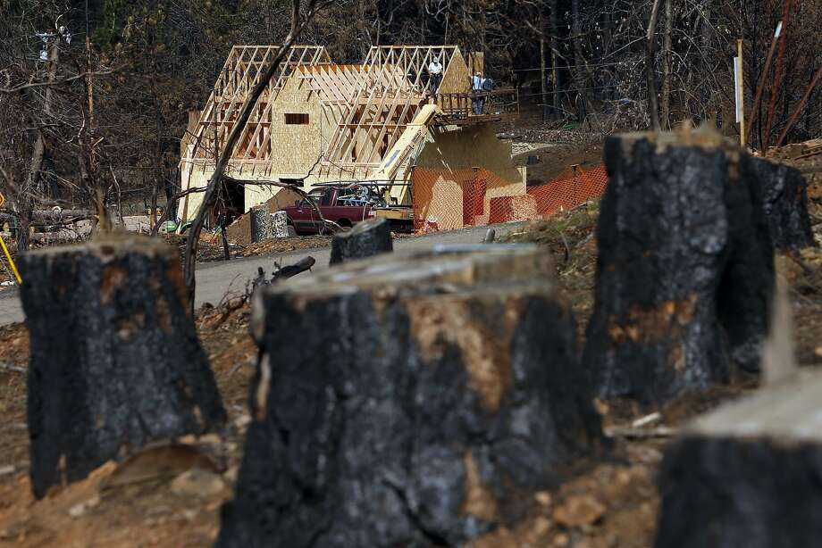 Above; A new house goes up in the after math of the Valley Fire in Cobb. Many in the Lake County area may not be able to rebuild until sewage and water systems are put in place. Photo: Scott Strazzante, The Chronicle