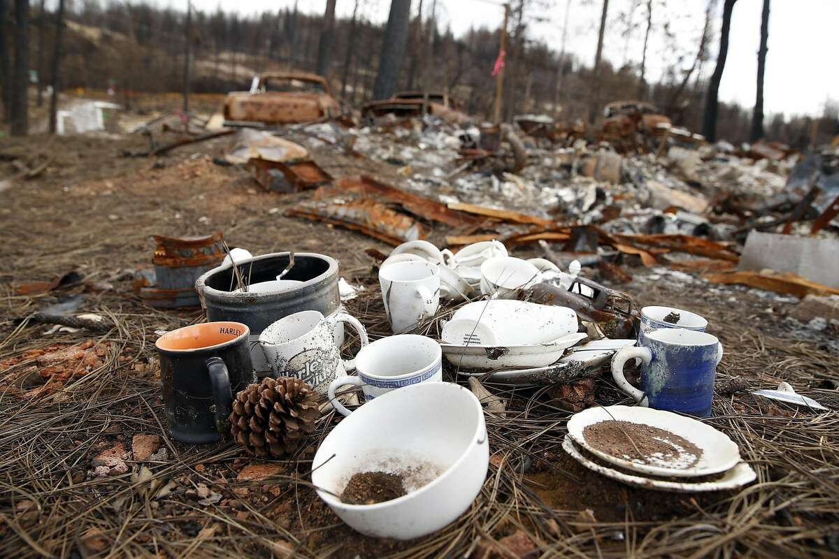 Recovered dishes remain on a lot on Humboldt Drive in the aftermath of the Valley Fire in Cobb, Calif., on Wednesday, March 2, 2016.