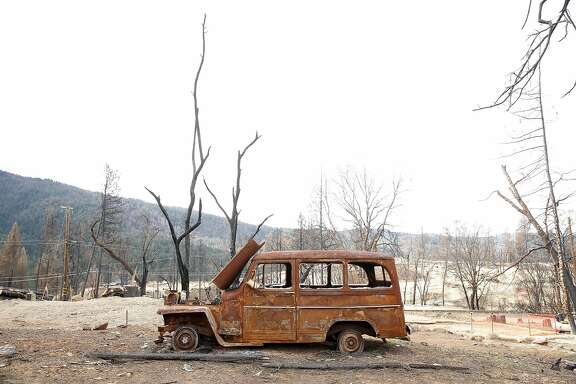 A burned out vehicle remains on a lot on Humboldt Drive in the aftermath of the Valley Fire in Cobb, Calif., on Wednesday, March 2, 2016.