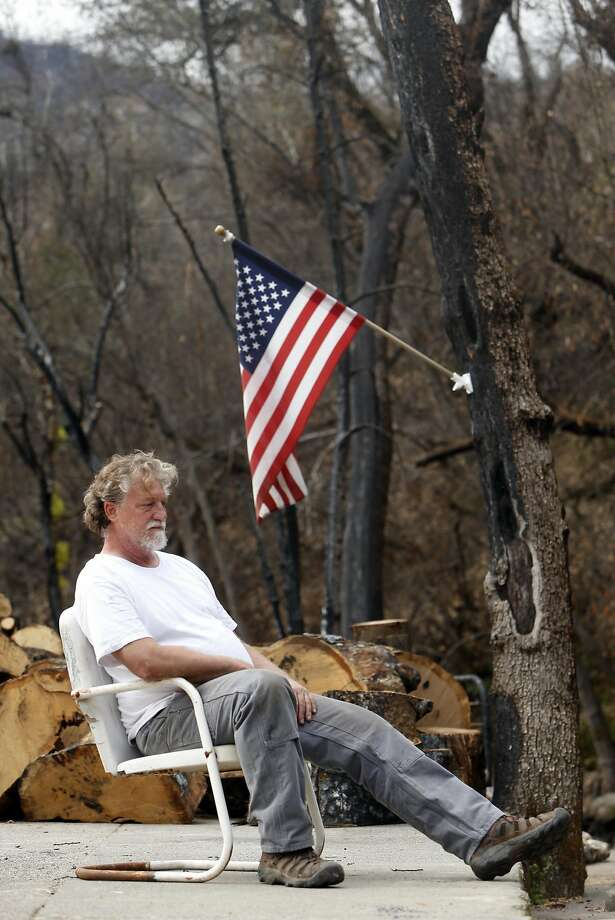 Buck Summers sits on his Anderson Springs lot burned by the Valley Fire. Photo: Scott Strazzante, The Chronicle