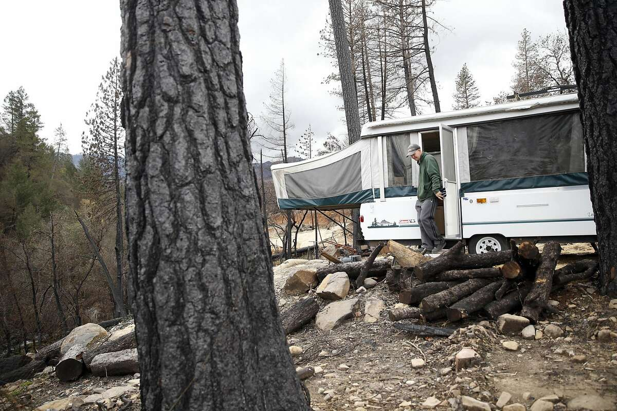 Daniel Laine exits a donated camper that he has been sleeping in during the aftermath of the Valley Fire on his family's property in Anderson Springs, Calif., on Wednesday, March 2, 2016.