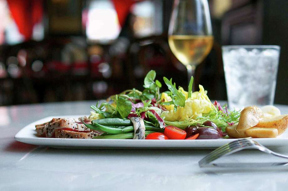 Toulouse Cafe and Bar, a Dallas-based restaurant, will open at River Oaks District, Houston, in March 2016. Shown: Salad Nicoise.