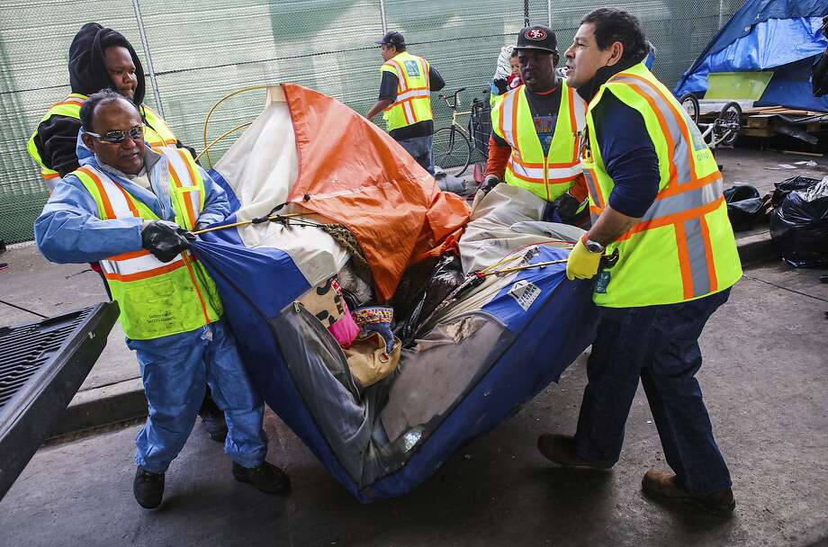 Department of Public Works employees haul an abandoned tent on Division Street in San Francisco, California, on Tuesday, March 1, 2016. Photo: Gabrielle Lurie, Special To The Chronicle