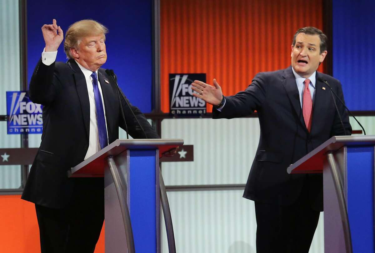 Donald Trump (left) was the subject of insults from Ted Cruz (right) and Marco Rubio during the Republican debate in Detroit.
