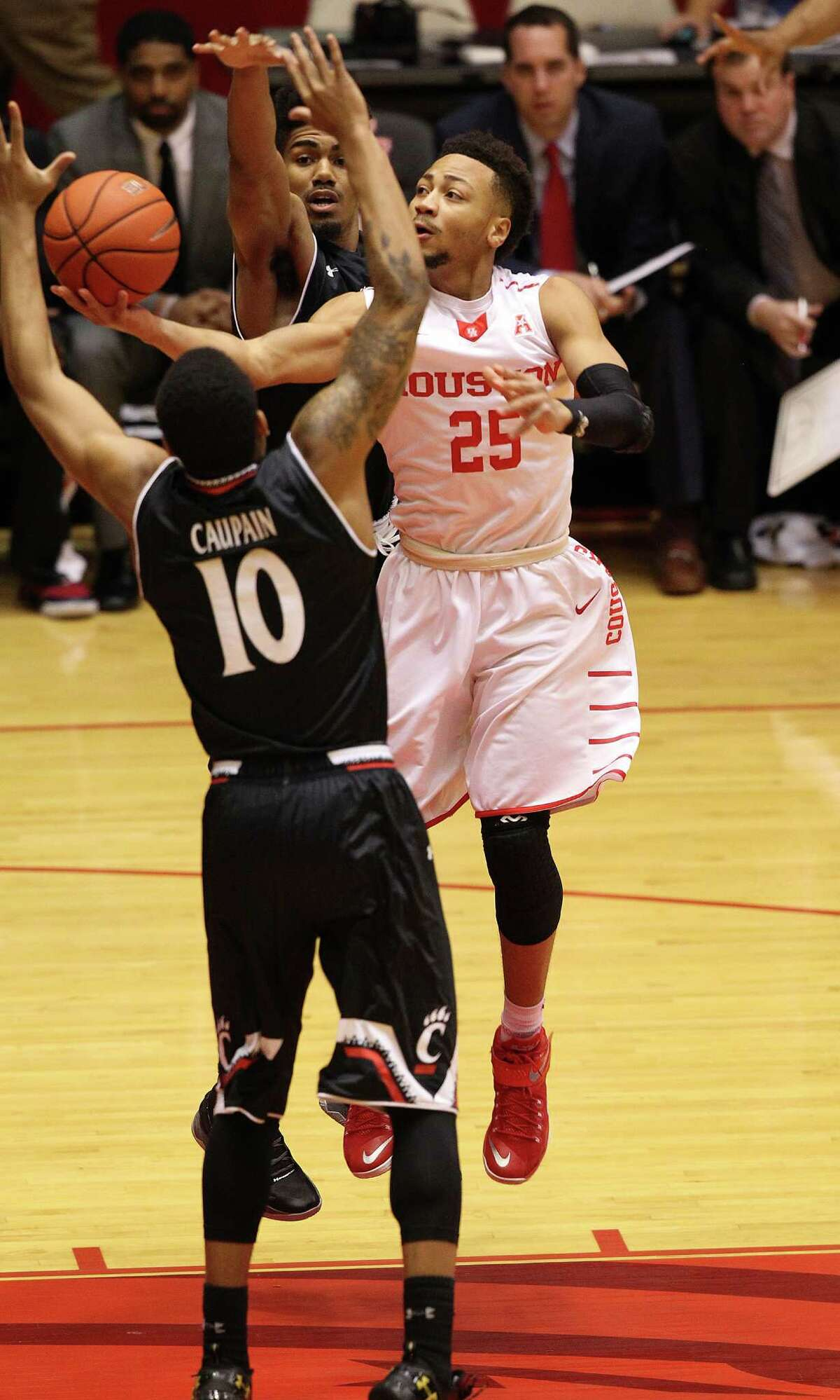 Houston Cougars guard Galen Robinson Jr. (25) puts up a shot around Cincinnati Bearcats guard Troy Caupain (10) in the first half of game action at Hofheinz Pavilion on Thursday, March 3, 2016, in Houston.