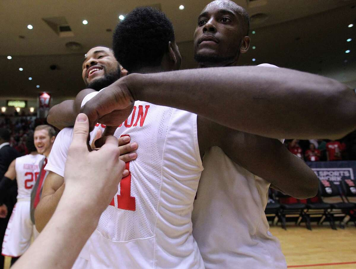Houston Cougars guard LeRon Barnes (4), from left, celebrates with Houston Cougars guard Damyean Dotson (21) and Houston Cougars forward Devonta Pollard (24) after the team's 69-56 win over Cincinnati Bearcats at Hofheinz Pavilion on Thursday, March 3, 2016, in Houston. Cougars won 69-56.