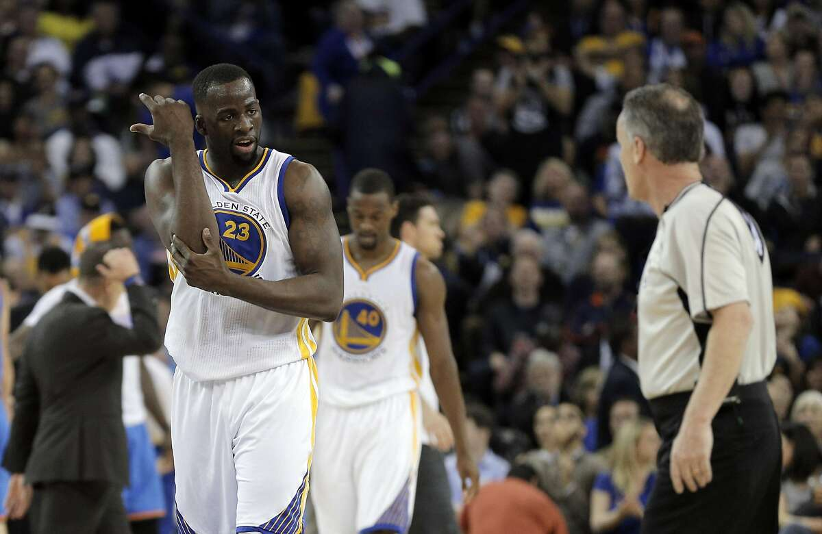 Draymond Green (23) gestures to an official about getting hit on the elbow on his last basket in the first half as the Golden State Warriors played the Oklahoma City Thunder at Oracle Arena in Oakland, Calif., on Thursday, March 3, 2016.