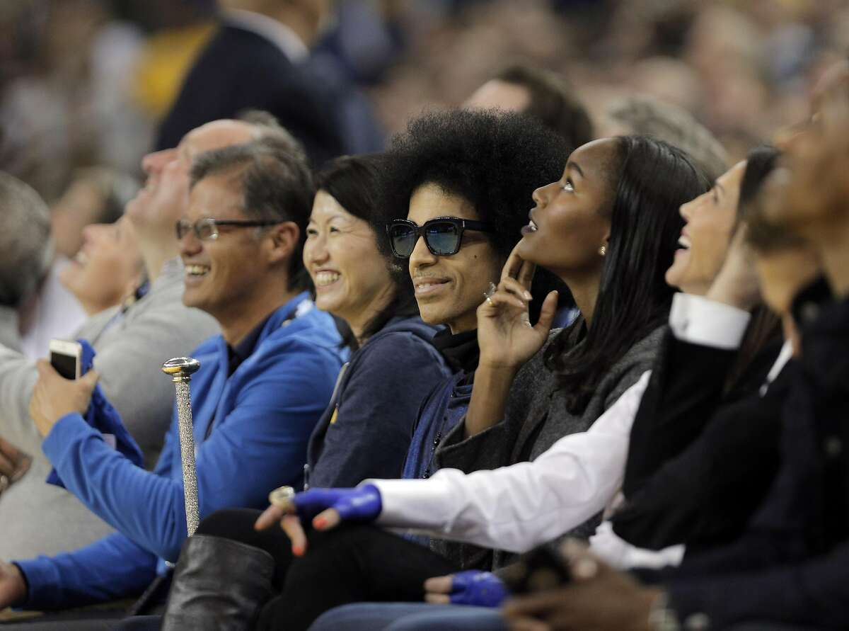 Prince sits courside in the first half as the Golden State Warriors played the Oklahoma City Thunder at Oracle Arena in Oakland, Calif., on Thursday, March 3, 2016.