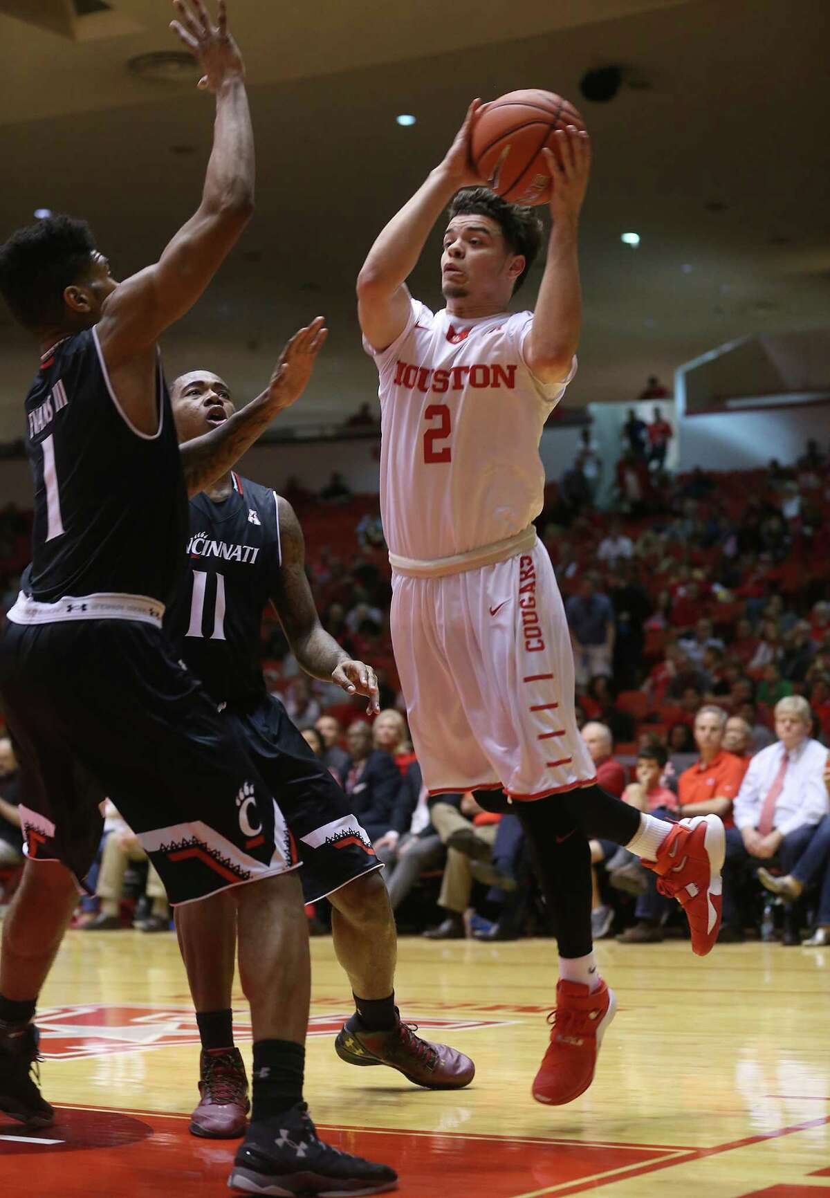 Houston Cougars guard Rob Gray Jr. (2) looks to dish off the ball in the paint in the first half of game action against Cincinnati Bearcats at Hofheinz Pavilion on Thursday, March 3, 2016, in Houston. Cougars won 69-56.