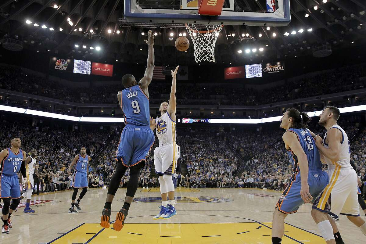 Golden State Warriors' Stephen Curry (30) drives to the basket as Oklahoma City Thunder's Serge Ibaka (9) defends during the first half of an NBA basketball game Thursday, March 3, 2016, in Oakland, Calif. (AP Photo/Marcio Jose Sanchez)