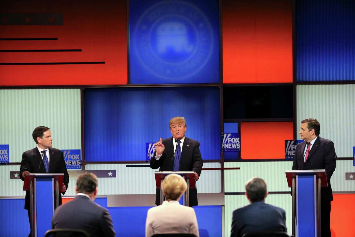 Sens. Marco Rubio and Ted Cruz, right, look on A Donald Trump speaks during a Republican presidential debate hosted by Fox News in Detroit, March 3, 2016. (Richard Perry/The New York Times) ORG XMIT: XNYT224
