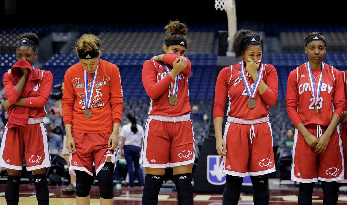 Crosby players receive their bronze medals following a UIL Class 5A girls high school state semifinal basketball game against Canyon, Thursday, March 3, 2016, in San Antonio. Canyon won 55-25.