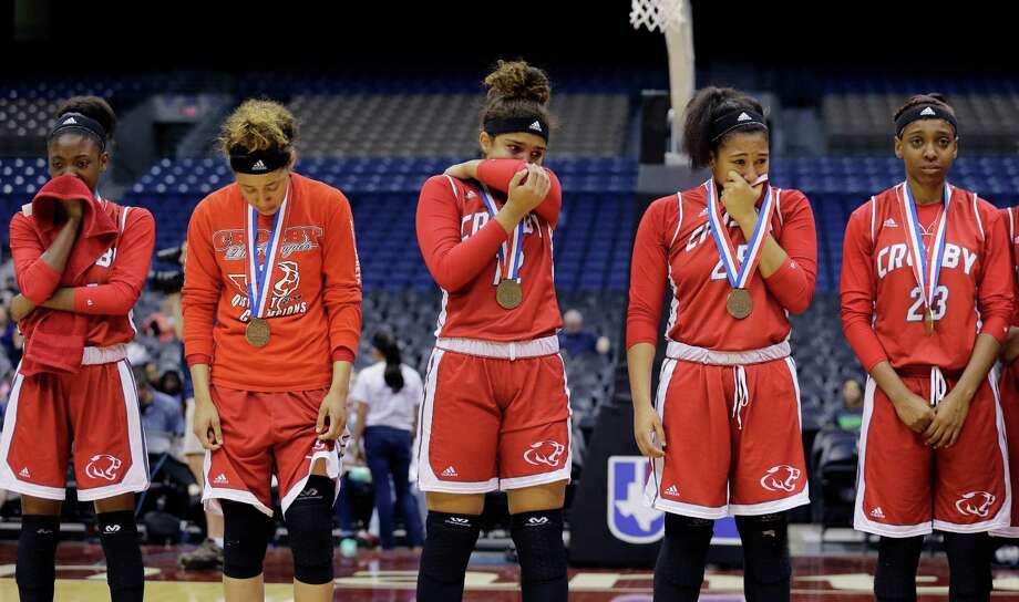 Crosby players receive their bronze medals following a UIL Class 5A girls high school state semifinal basketball game against Canyon, Thursday, March 3, 2016, in San Antonio. Canyon won 55-25. Photo: Eric Gay, AP / AP