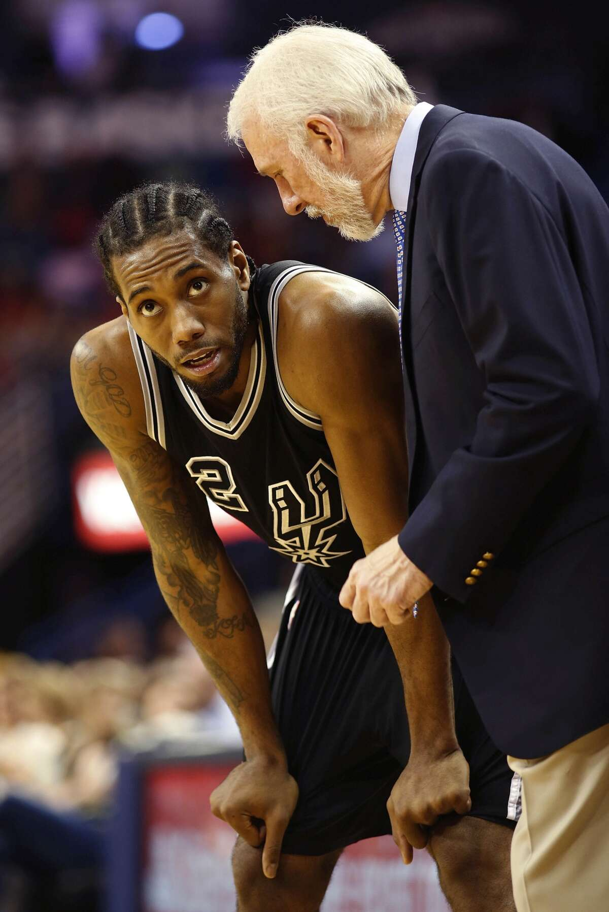 San Antonio Spurs forwardKawhiLeonardtalks to San Antonio Spurs head coach Gregg Popovich between plays in the second half of an NBA basketball game in New Orleans, Thursday, March 3, 2016. The Spurs beat the Pelicans 94-86. (APPhoto/Max Becherer)---