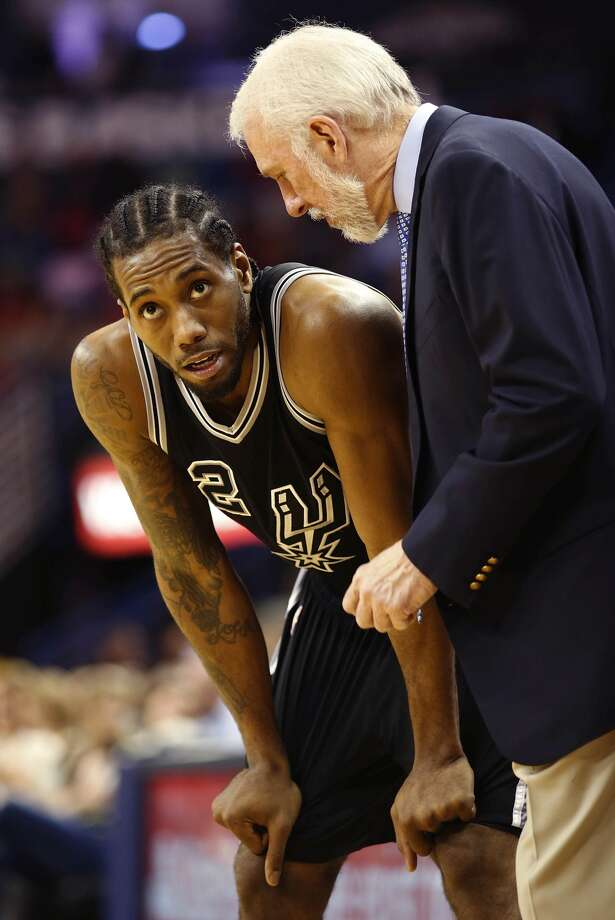 San Antonio Spurs forward Kawhi Leonard talks to San Antonio Spurs head coach Gregg Popovich between plays in the second half of an NBA basketball game in New Orleans, Thursday, March 3, 2016. The Spurs beat the Pelicans 94-86. (AP Photo/Max Becherer)--- Photo: AP Photo/Max Becherer